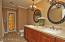 Dual sinks, stone countertop, beautiful cabinetry