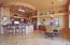 large breakfast bar, good size eat in area, plant shelves, pendelum lighting.
