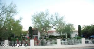 Lovely gated front yard adds to this Estate's privacy.