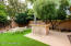The professionally landscaped yard includes mature Lemon, Mexican Lime and Naval Orange trees.