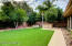 Huge grassy yard featuring high quality artificial turf is perfect for a children's play area.