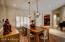 Dining room features recessed lighting and plantation shutters