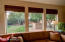The bamboo blinds chosen by the interior designer roll up to bring the outside in.