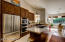This spacious kitchen features high end stainless steel appliances.