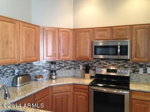 Newly updated with awesome tile back splash & hardware! Features granite counters, breakfast bar and stainless steel appliances.