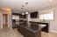 Remodeled Kitchen with large kitchen island with black granite and counters around sink and range are a beautiful Venetian gold.