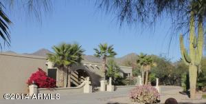 Home is framed by the McDowell Mountains in the background.
