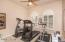 Notice the shutters and ceiling fans throughout!