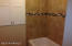New linen closet, tub and tiled shower in hall bath