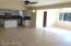 Sunny, open view of kitchen, dining, family room area