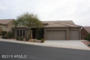 Huge single level home with South Mountain trails just up the street. Professionally landscaped desert scape to enjoy while sitting on the front covered patio. The front door looks like wood but is fiberglass. It has been beautifully custom designed for this home.