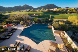 Amazing resort style yard with negative edge pool, firepit, multiple seating areas, BBQ, bar and mounted flat screen TV and more! Enjoy the Scottsdale lifestyle!