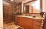 Huge walk in shower with granite counters and private water closet