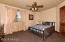 This guest room is just next to the front Foyer and features a queen bed chest and flat screen