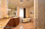 This bath is enormous and contains a claw foot tub, large snail shower, and huge mirrors