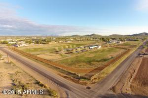 Rare & Large approximately 16.5 combined acres in Desert Hills area with horse facilities. Two lots, to be sold together. Lots of frontage to Cloud & 11th Ave with main & guest/hand houses. Buyer to verify all material facts, including measurements.