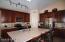 Beautiful Cabinetry... Practical 'Stonite' Counters looks like Granite... Wonderful Center Island.
