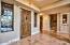 Notice the beautiful solid wood front door and travertine floors.