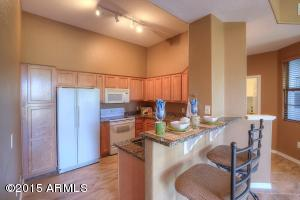 Lovely kitchen with upgraded cabinets, granite countertops, and breakfast bar that overlooks the great room.