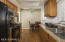 Remodeled kitchen with new cabinetry, slab granite counters and newer appliances.
