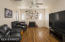 The living room maintains the 1929 vintage vibe with the original hardwood floors and (gas) fireplace.