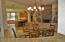LOOKING INTO THE BREAKFAST AREA, KITCHEN & FAMILY ROOM FROM THE LIVING ROOM OVER THE WET BAR