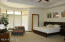 SPACIOUS MASTER BEDROOM SUITE W/DIRECT ACCESS TO THE BACKYARD