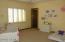 BEDROOM 3 - IN GUEST WING W/PLANTATION SHUTTERS, WALK-IN CLOSET AND EN-SUITE BATH