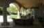 LARGE AMOUNTS OF COVERED PATIO FOR OUTDOOR DINING AND ENTERTAINING