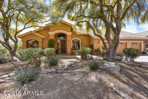 Beautiful TW Lewis home with adjacent desert wash on east side of home.