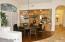 ELEGANT DINING ROOM W/BUILT-IN CABINETS & PLANTATION SHUTTERS