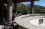 Huge granite bar around the outdoor kitchen with bar stools