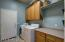 Cabinets on both sides of Laundry Room!