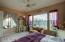 Bedroom with lots of windows, overlooking mountains, back patio and desert!