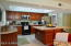 There's plenty of room at the kitchen island for kitchen helpers, homework or just casual dining.
