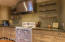 Designer kitchen all with custom cabinetry, vintage gas stove