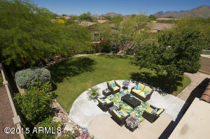 One of the largest yards on the street. Large curved patio with grassy play area.