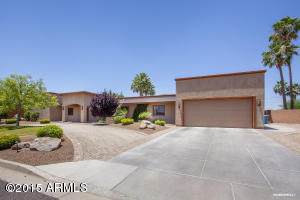 Ranch-style home on over 1/2 acre has circular drive for guests, plus oversized 2 car garage with extra parking in the drive.
