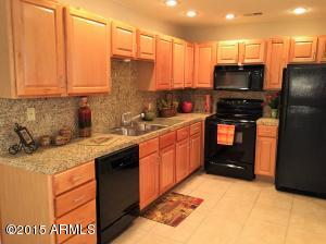 Beautiful kitchen with newer Kenmore appliances, SS sink, maple cabinets, and Granite!