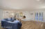 Great room opens to a full wet bar and wine cellar