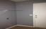 Clean and Freshly Painted! Opens to Garage. Casual Grey's the Color!