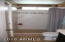 Tiled shower of hall bath. Also has access to 3rd bedroom