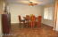 Feast with groups large or small in this Dining room, open to Kitchen and Living Room