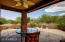 Covered Patio with views of rock water feature- wonderful soothing sounds to relax!