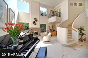 with dramatic curved staircase & balcony!