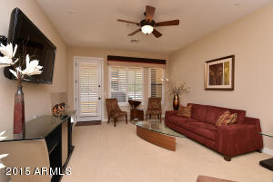 Ample seating area and plantation shutters on the widows and door