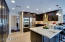 Beautiful kitchen with GE Café appliances, soft close drawers, stone flooring, granite countertops, wine refrigerator, ss cooktop hood and solid wood cabinetry!