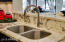 Undermount stainless steel sink with airtouch garbage disposal, single hole high faucet, full granite counters!