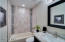 Full bathroom attached to second bedroom is gorgeous!