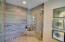 Generous walk in shower with custom marble tile walls and floor